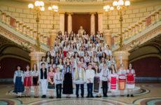 At The Romanian Athenaeum -  Concert coral -  Corul Symbol -  Cântând Centenarul Unirii  Corul SYMBOL  Director-dirijor JEAN LUPU -  Dirijor principal LUMINIŢA GUŢANU STOIAN -  Soliste ANDREEA DASCĂLU, CORINA GATU -  La pian MAGDALENA BULIBAŞA, BIANCA FODOR, CRISTINA GHEORGHE La chitară ANDREEA SILIVESTRU -  Percuţie PETRE MIHĂILESCU -  Prezentator DANIELA GREERE -  Mişcare scenică ANCA IORGA -  Program -  Anton Pann - Imnul României (versuri Andrei Mureşanu) -  Ion Popescu Pasărea/Nicolae Lungu - Ziua învierii -  Gavriil Musicescu - Concertul nr. 1, p. I -  Anton Pann  - Troparul -  Alexandru Cristea - Limba noastră (versuri Alexei Mateevici) -  Constantin Arvinte - Diptic maramuresan (p. a. a.) -  Gheorghe Şoima - Jieneasca -  Nelu Ionescu - Cuc, cuculeț   -  Gheorghe Danga - În poieniţă  -  Valentin Gruescu - Sorocul  -  Alexandru Pașcanu - Chindia  Ioan Christu Danielescu - Voinţa neamului (versuri Ioan Nemţescu) -  Ion Vidu - Răsunet de la Crişana -  Constantin Arvinte - Hăulita gorjenească -  Joseph Strauss - Polca fierarului (p. a.) -  Marin Velea - Oltule, râu blestemat  -  A. Papin - Sărbătoarea andaluză -  Petre Ştefănescu - Jocuri (p. a. a) -  Mihai Moldovan - Joc din Oaș  -  Irina Odăgescu - Despre pace -  George Enescu - Rapsodia I (aranj. Constantin Drăguşin) -